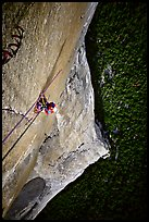 Belaying the following pitch, a thin crack in the middle of nowhere. El Capitan, Yosemite, California