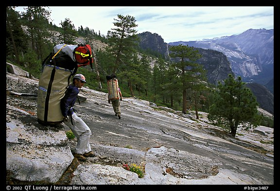 Taking a break while going down the east ledges. El Capitan, Yosemite, California (color)