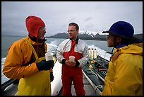 Kayakers in dry suits on the deck of Glacier Bay Lodge concession boat. Glacier Bay National Park, Alaska