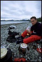 Eating on the shores of Muir Inlet. Glacier Bay National Park, Alaska (color)