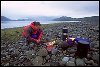 Kayaker firing up the stove,  Muir Inlet. Glacier Bay National Park, Alaska