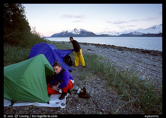 Kayakers getting into their tents for the night,  East Arm. Glacier Bay National Park, Alaska (color)