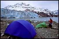 Campers set-up a tent in front of Lamplugh Glacier. Glacier Bay National Park, Alaska (color)
