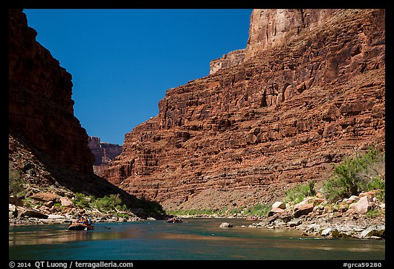 Rafts on Colorado River below towering cliffs. Grand Canyon National Park, Arizona (color)