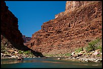 Rafts on Colorado River below towering cliffs. Grand Canyon National Park, Arizona ( color)
