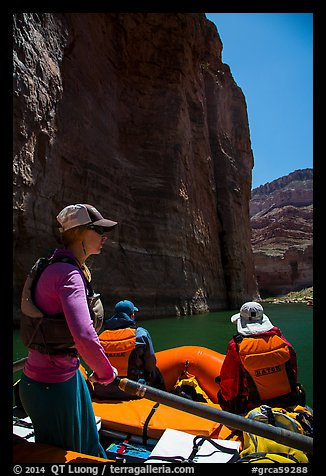 On raft below redwall limestone cliff dropping straight into Colorado River. Grand Canyon National Park, Arizona (color)