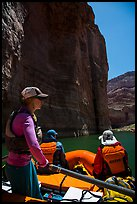 On raft below redwall limestone cliff dropping straight into Colorado River. Grand Canyon National Park, Arizona