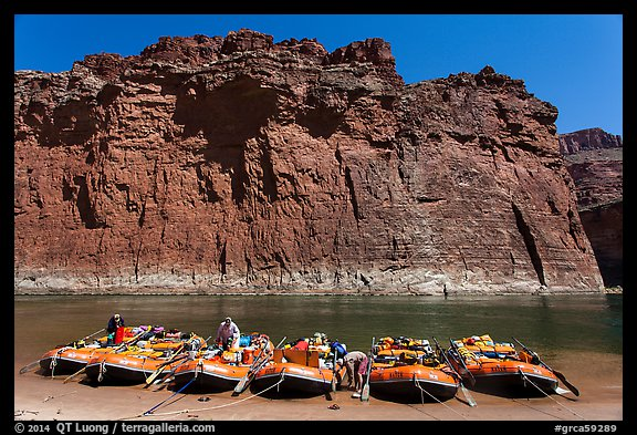 Rafts moored opposite redwall limestone cliff. Grand Canyon National Park, Arizona (color)