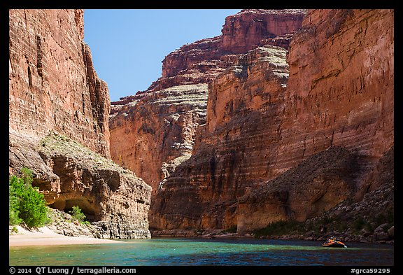 Raft dwarfed by huge Redwall limestone canyon walls. Grand Canyon National Park, Arizona (color)
