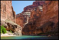 Raft dwarfed by huge Redwall limestone canyon walls. Grand Canyon National Park, Arizona