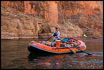 Paddling calm stretch of Colorado River between towering walls. Grand Canyon National Park, Arizona ( color)