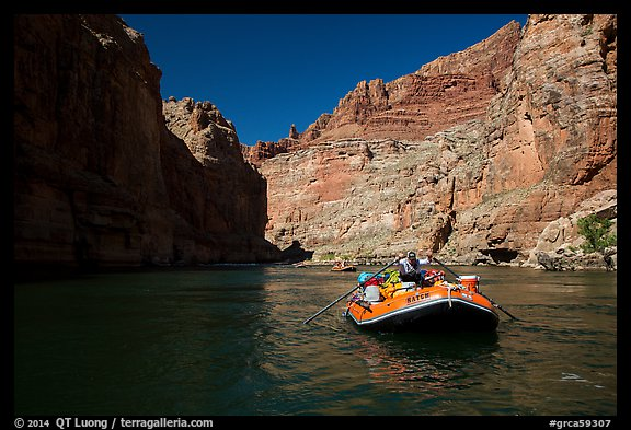 Paddling calm stretch of Colorado River beneath towering walls. Grand Canyon National Park, Arizona (color)