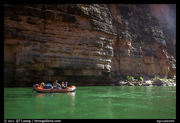 Oar raft on green waters below canyon walls, Marble Canyon. Grand Canyon National Park, Arizona (color)
