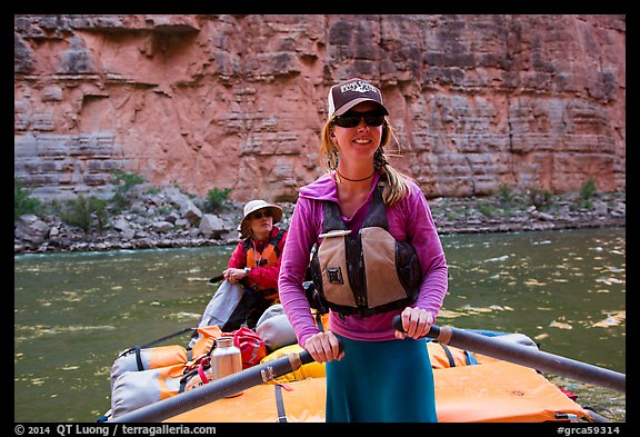 River guide rowing oar raft in narrow canyon. Grand Canyon National Park, Arizona (color)