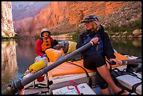 River guide converses with passenger on raft, Marble Canyon. Grand Canyon National Park, Arizona