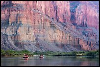 Rafts dwarfed by cliffs above the Colorado River. Grand Canyon National Park, Arizona