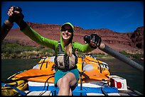 Woman paddling oar-powered raft. Grand Canyon National Park, Arizona ( color)