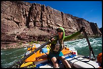 Woman stirring raft with oars in rapid. Grand Canyon National Park, Arizona ( color)