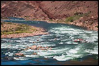 Motor-powered raft navigating Hance Rapids. Grand Canyon National Park, Arizona ( color)