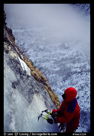 Topping out the stalactite of the Moulins Falls, La Grave. Alps, France (color)