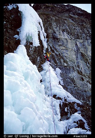 One month later, despite degrading conditions, Kevin Normoyle efficiently led the first two mixed pitches. He is at the crux move, oblique, overhanging, and thin. Lilloet, British Columbia, Canada (color)