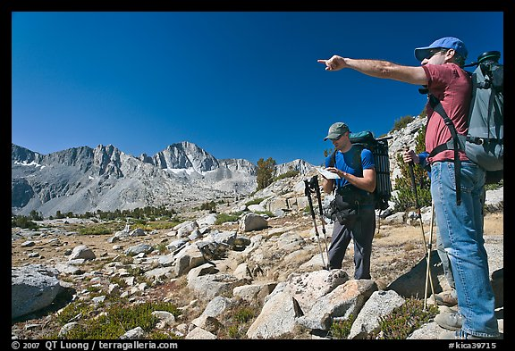 Hikers looking at map and pointing, Dusy Basin. Kings Canyon National Park, California (color)