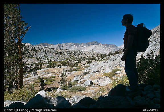 Hiker silhouetted, lower Dusy Basin. Kings Canyon National Park, California (color)