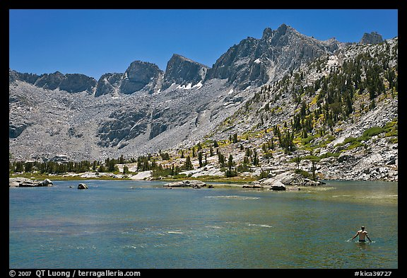 Man bathing in alpine lake, lower Dusy Basin. Kings Canyon National Park, California (color)