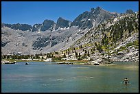 Man bathing in alpine lake, lower Dusy Basin. Kings Canyon National Park, California