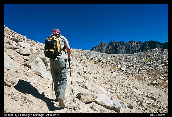 Hiker heading towards Biship Pass, Dusy Basin. Kings Canyon National Park, California (color)