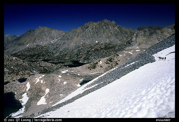 Backpackers on a snow field at a high pass. Kings Canyon National Park, California (color)