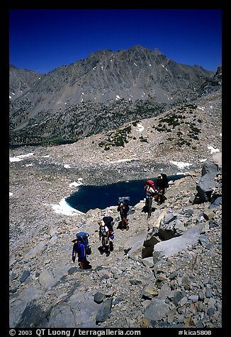 Backpackers near a tarn Lake. Kings Canyon National Park, California (color)
