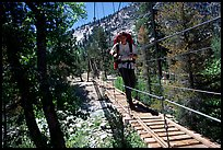 Crossing a river on a suspension footbridge. Kings Canyon National Park, California