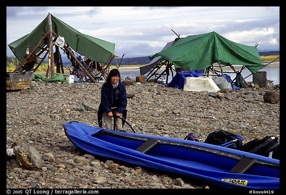 Inflating the canoe next to an Eskimo fish camp in Ambler. Kobuk Valley National Park, Alaska (color)