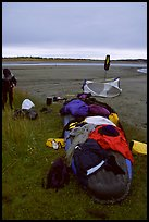 Gear laid out for drying on the bottom of the canoe on a small island of the Kobuk River. Kobuk Valley National Park, Alaska (color)