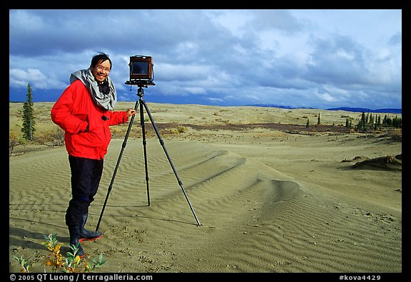 Large format photographer QT Luong with camera on Kobuk Dunes. Kobuk Valley National Park, Alaska (color)