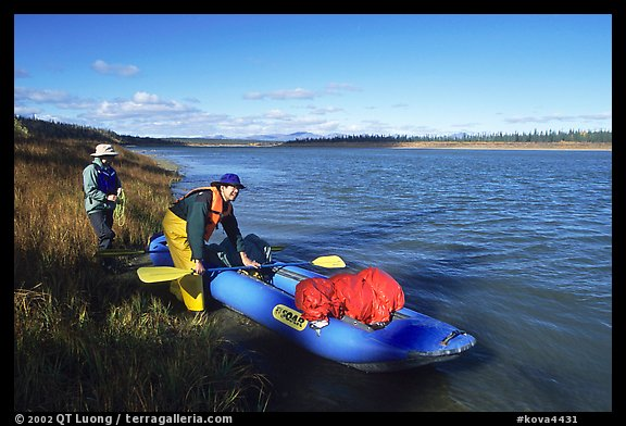 Canoeists prepare to lauch on the Kobuk River. Kobuk Valley National Park, Alaska (color)