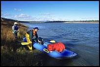 Canoeists prepare to lauch on the Kobuk River. Kobuk Valley National Park, Alaska