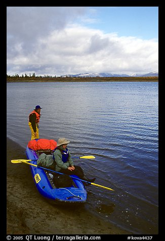 Canoeists ready to lauch with the boat loaded up. Kobuk Valley National Park, Alaska (color)