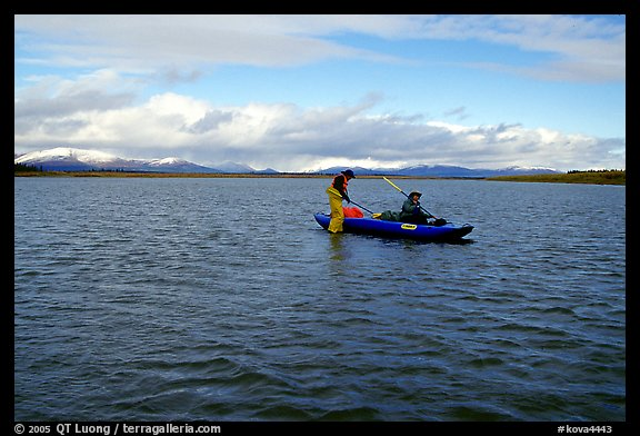 Canoeists on a wide and very shallow stretch of the Kobuk River. Kobuk Valley National Park, Alaska (color)