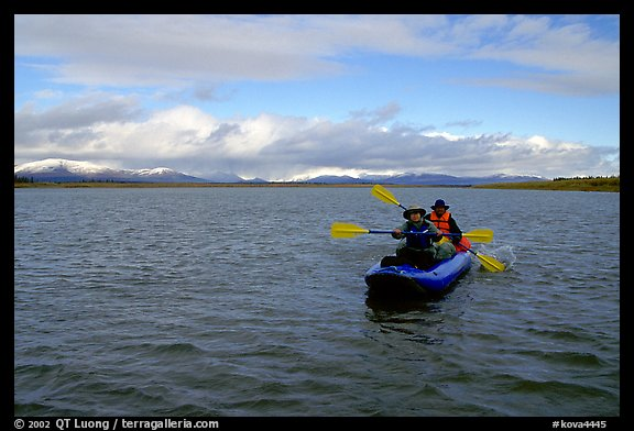 Canoeists Paddling on the wide Kobuk River. Kobuk Valley National Park, Alaska (color)