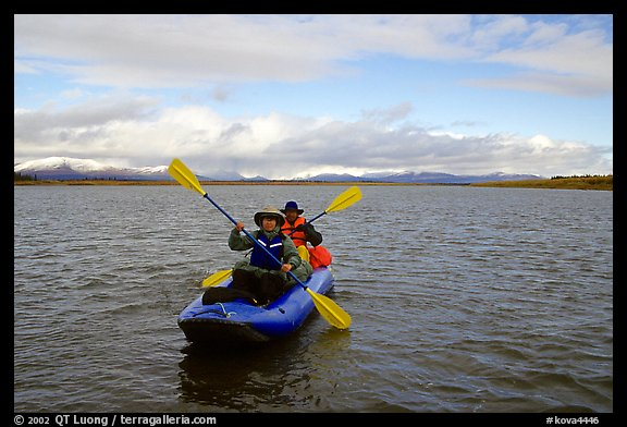 Canoeists Paddling on the Kobuk River. Kobuk Valley National Park, Alaska (color)