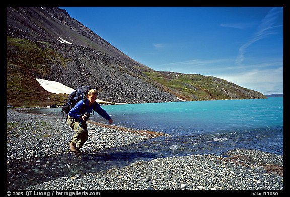 Jumping over a small stream next to Lake Turquoise. Lake Clark National Park, Alaska (color)