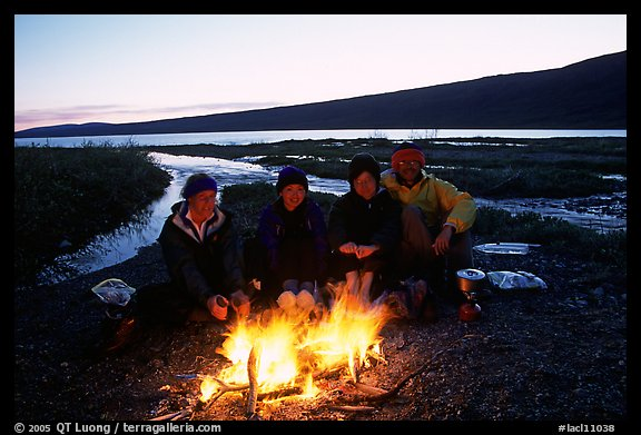Warming toes on campfire next to Turquoise Lake. Lake Clark National Park, Alaska (color)