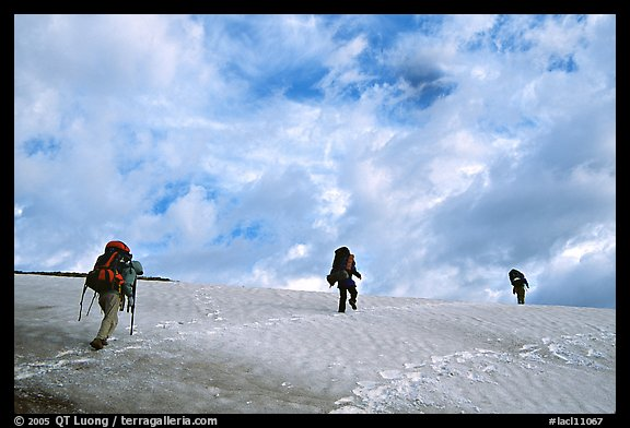 Backpackers crossing a neve. Lake Clark National Park, Alaska (color)