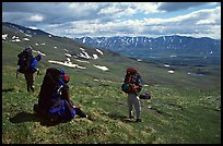 Backpackers take a pause when arriving on sight of Twin Lakes. Lake Clark National Park, Alaska