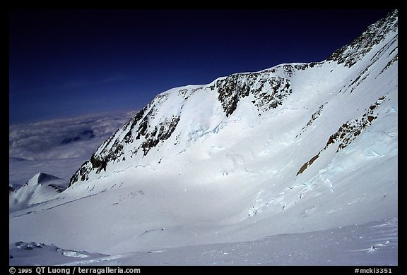 I leave by myself the camp for a summit attempt, taking a cut-off to the West Rib. The West Buttress route goes to the pass, through the steep wall, and is quite crowded. Denali, Alaska (color)