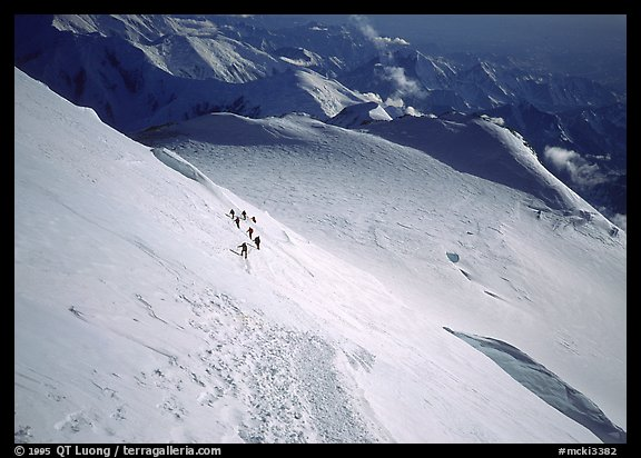The treacherous Denali Pass, scene of numerous accidents. The descending traverse is somewhat delicate for tired climbers. Moreover some take only ski poles and therefore cannot self-arrest. Denali, Alaska (color)