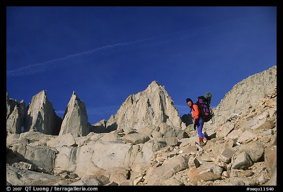 Woman with backpack hiking at the base of Mt Whitney. Sequoia National Park, California (color)