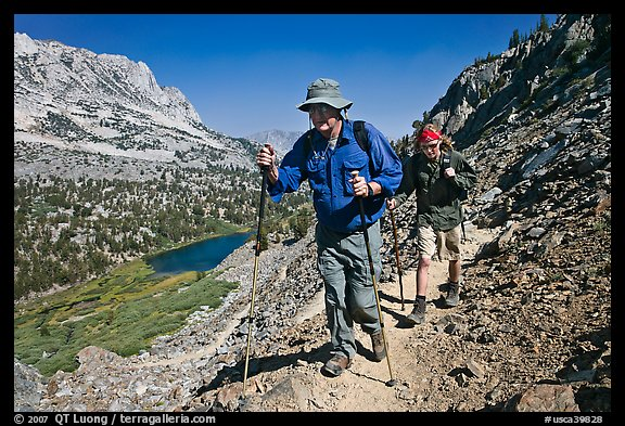 Father and son on trail above Long Lake, John Muir Wilderness. Kings Canyon National Park, California (color)